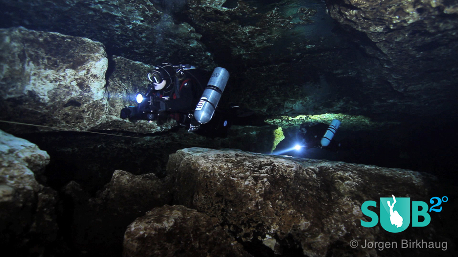 A team of cave divers approaching The Lips in Devil's Eye Cave.