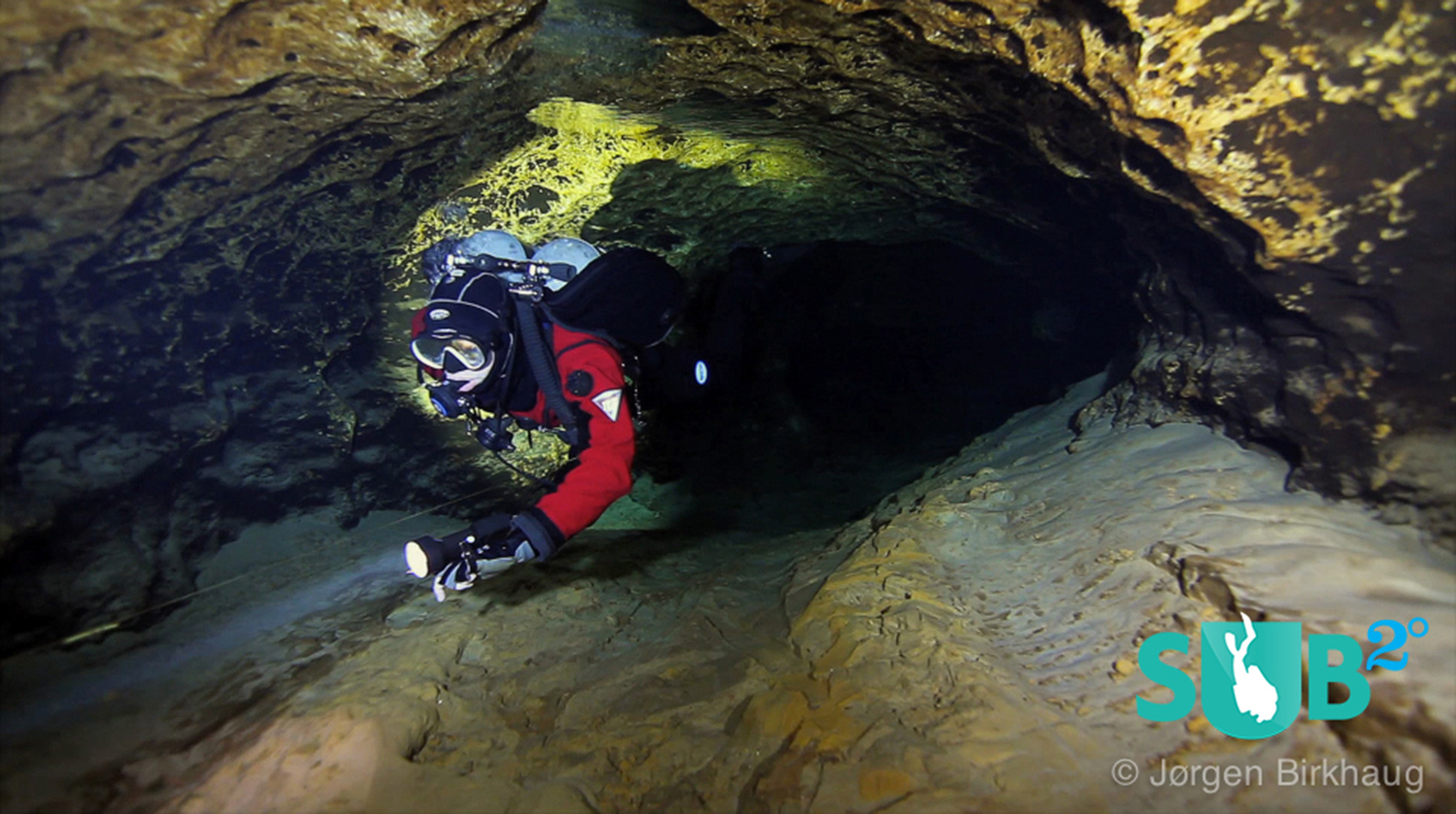 Cave diver in Devil's Eye cave following the double lines.