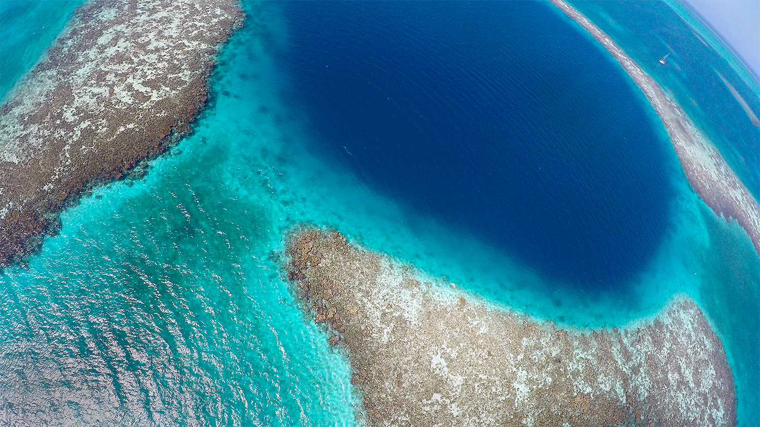 Took the drone on our trip to the Blue Hole and risked it in the gusty wind to get this shot.