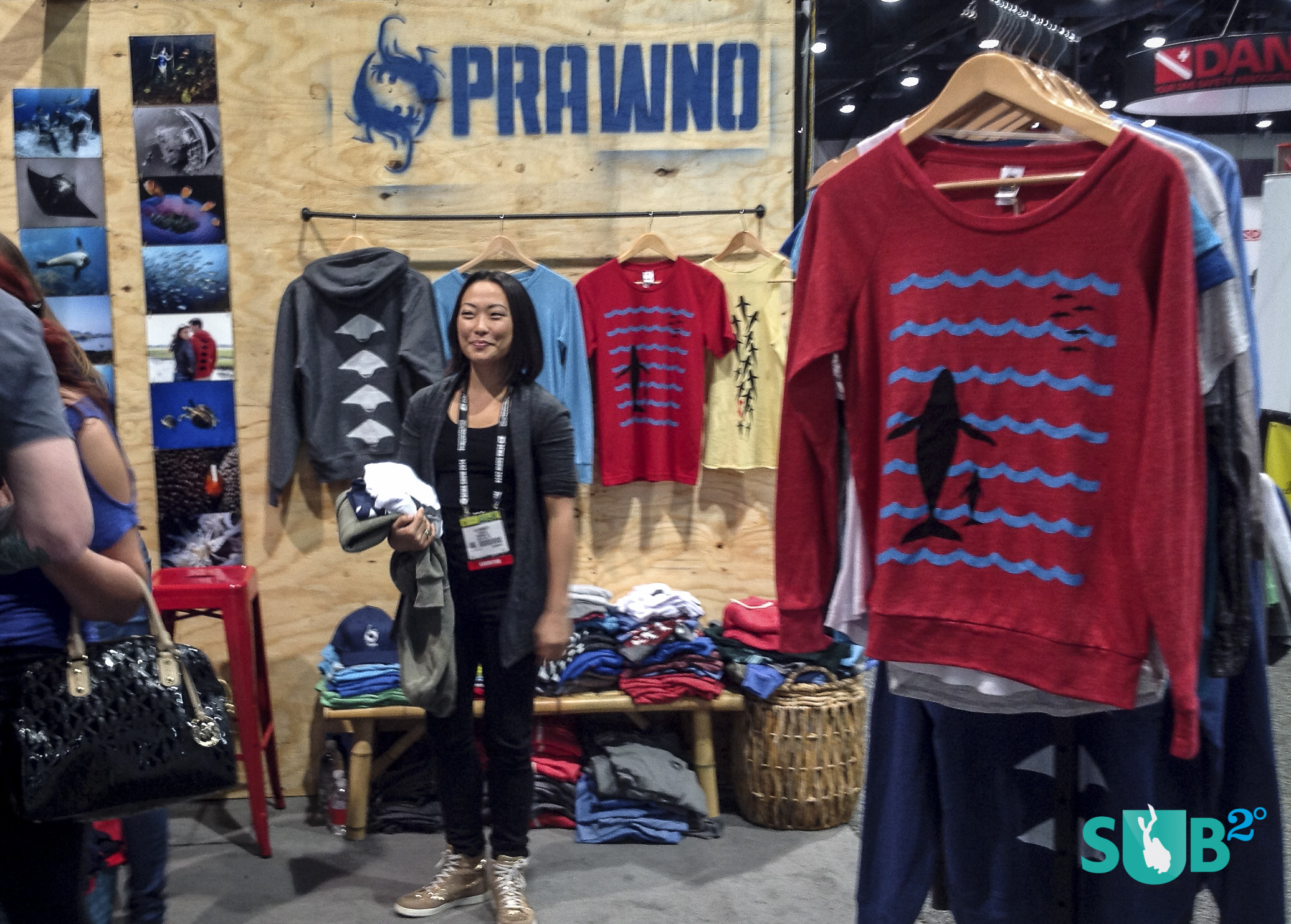 Lia Barrett, creative director for Prawno Apparel, shows off their fashionable ocean-minded clothing line.