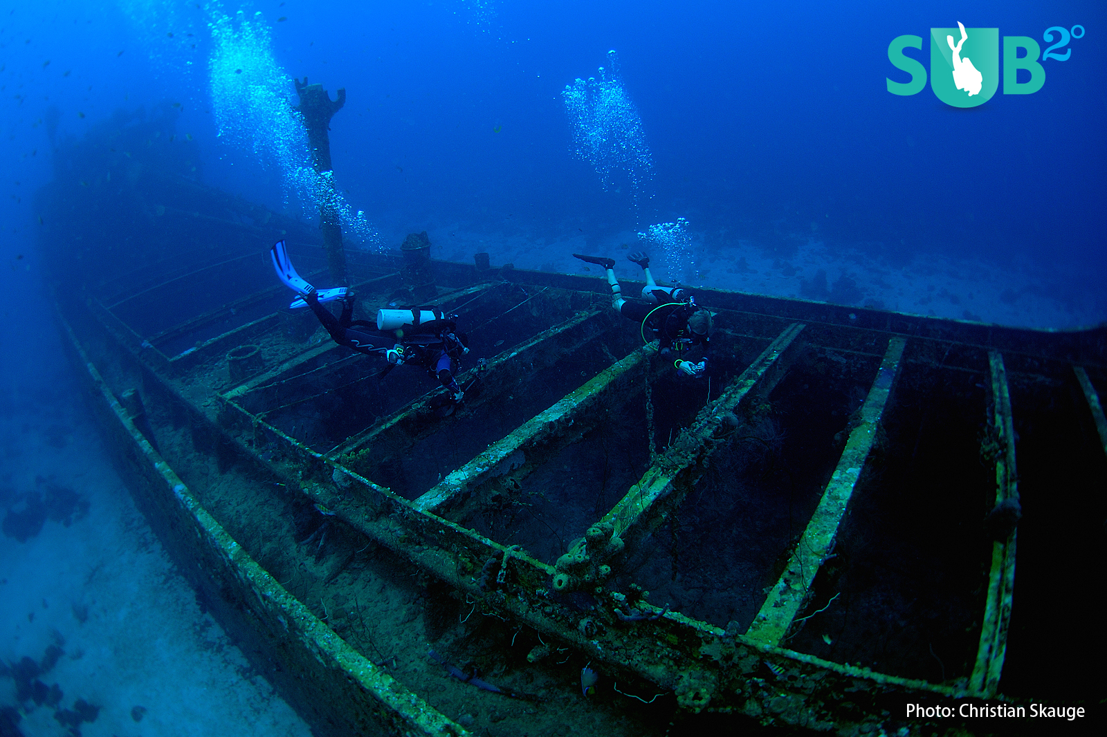A wreck shows itself in blue and green colors at depth, unless you bring an artificial light source.