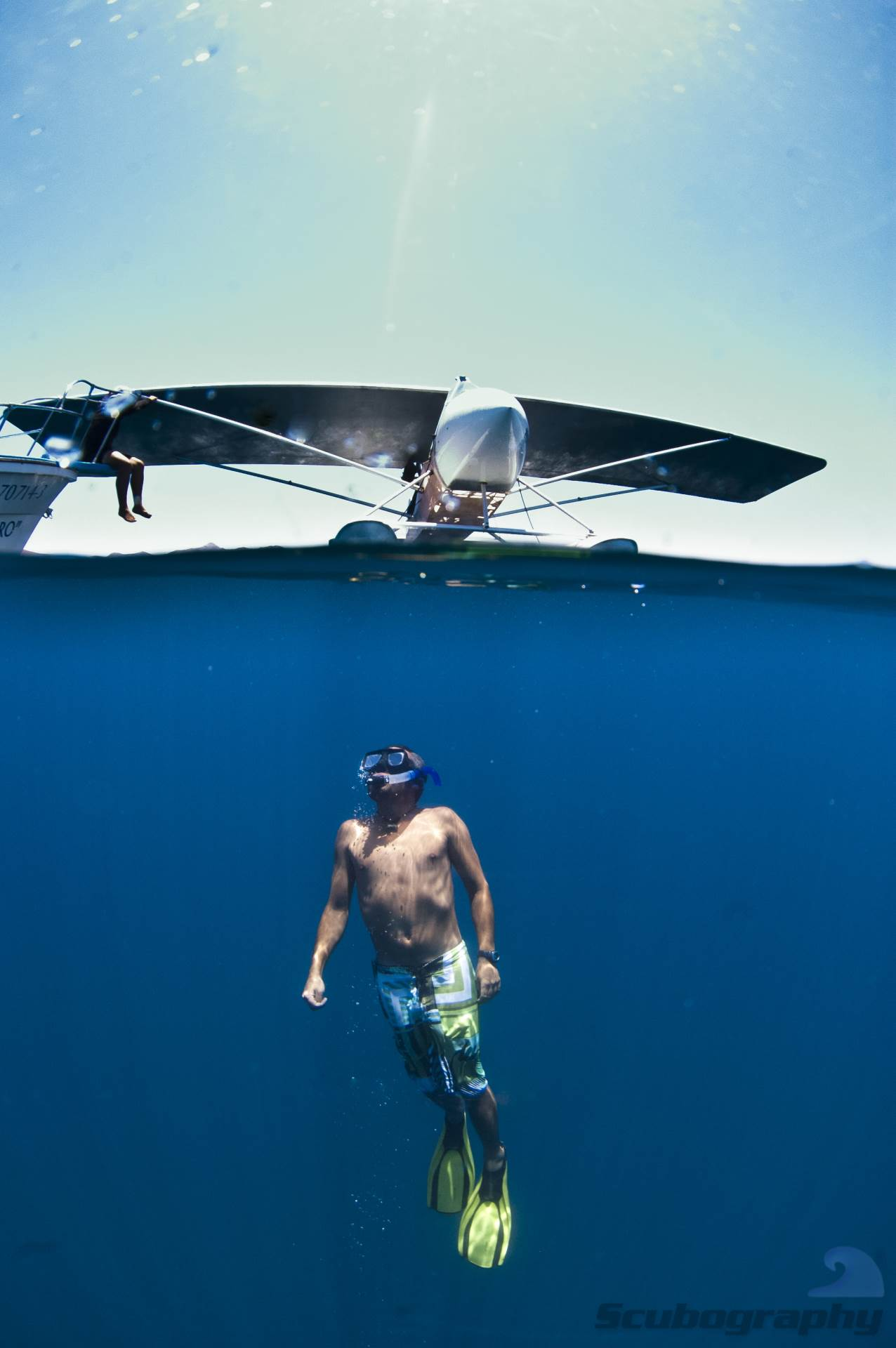 The pilot of our whale shark spotter plane cooling off in the afternoon.