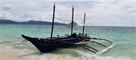 The Nauti Lass dive boat of white beach divers Boracay