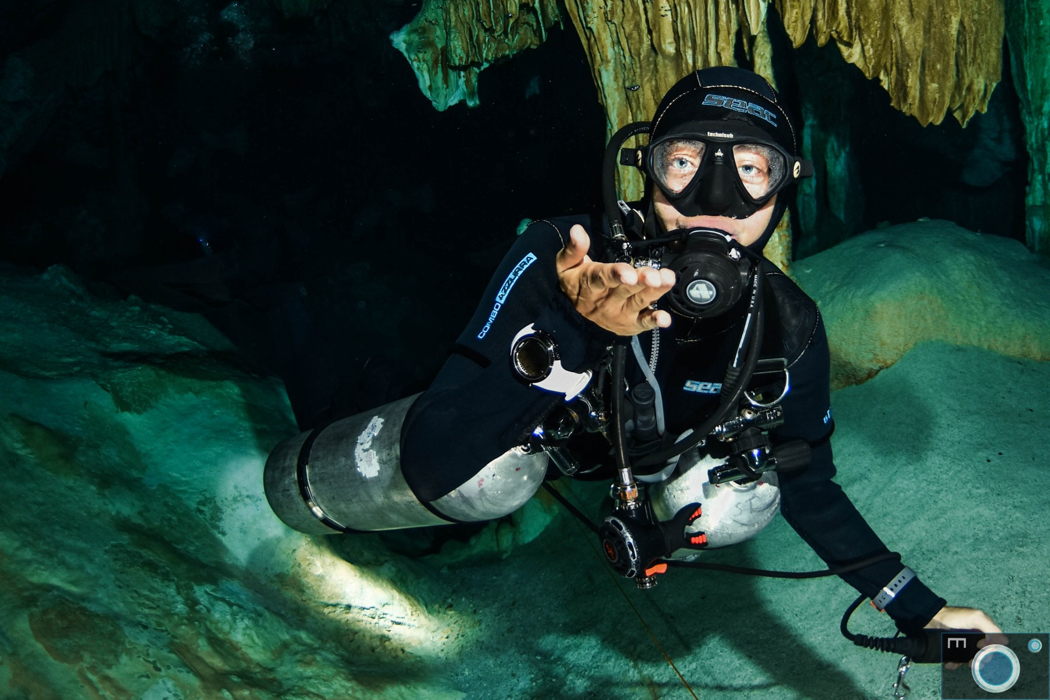 Cenote Guide at Cenote Dos Ojos. The Stalagtites & stalagmites are awesome. Come and see for yourself with Best Cenote Dives.