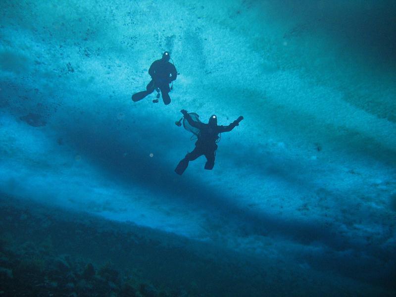 Divers under ice