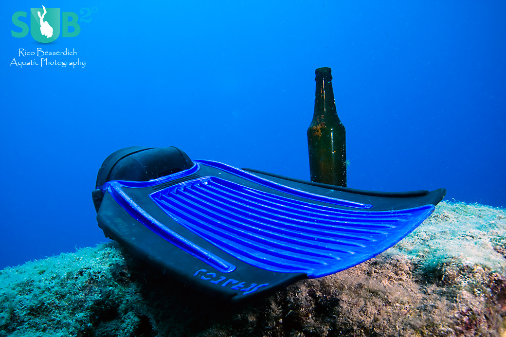 The most boring dive of my life. Found a rock and a beer bottle. Added my own fin to have at least 1 more subject in the picture. Not suitable for competitions but I've kept it as a personal memory.