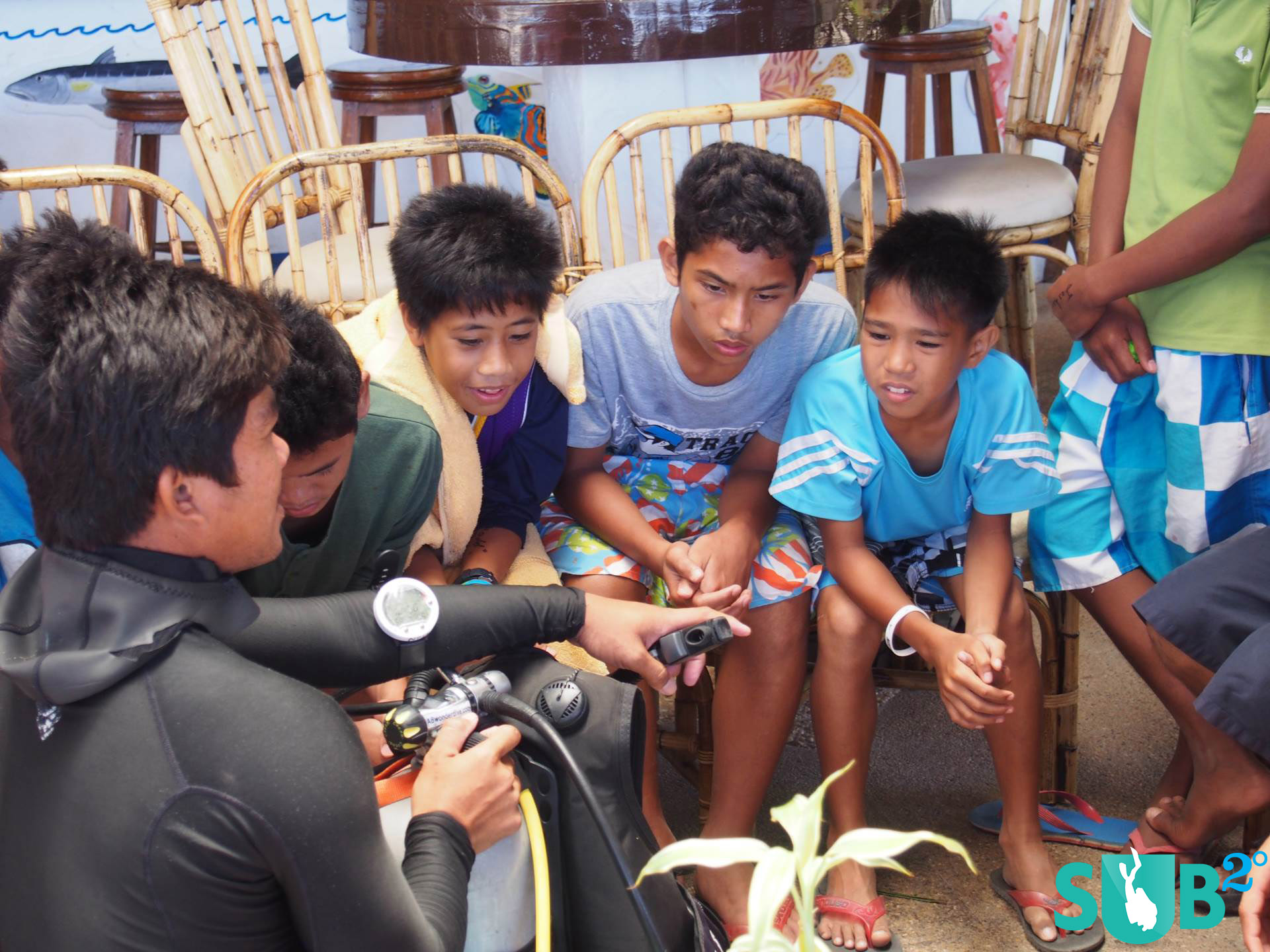 Kids listening intently on how scuba gear works.