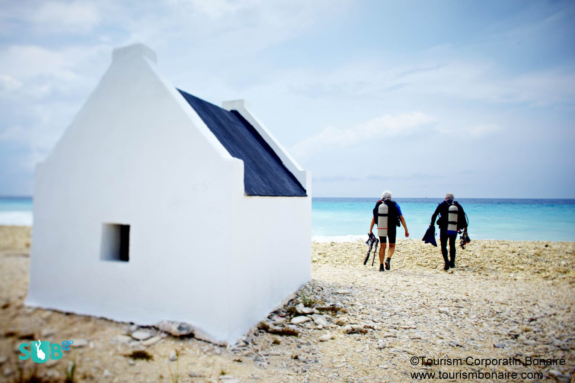 Divers effortlessly walk to the entry point of one of Bonaire's many fantastic shore dives.