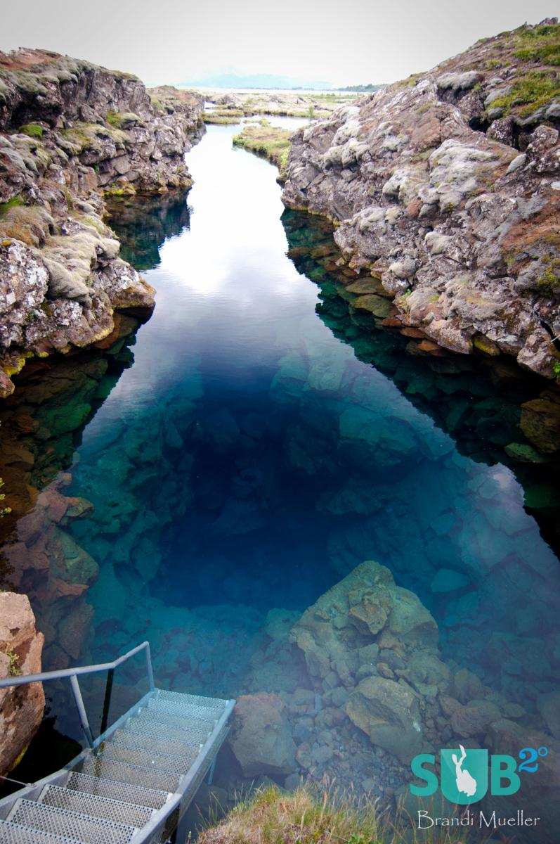The ladder that takes you into the crack.  Glacier water filtered through miles and miles of volcanic rock feed Lake Þingvallavatn making it extraordinarilty clear.