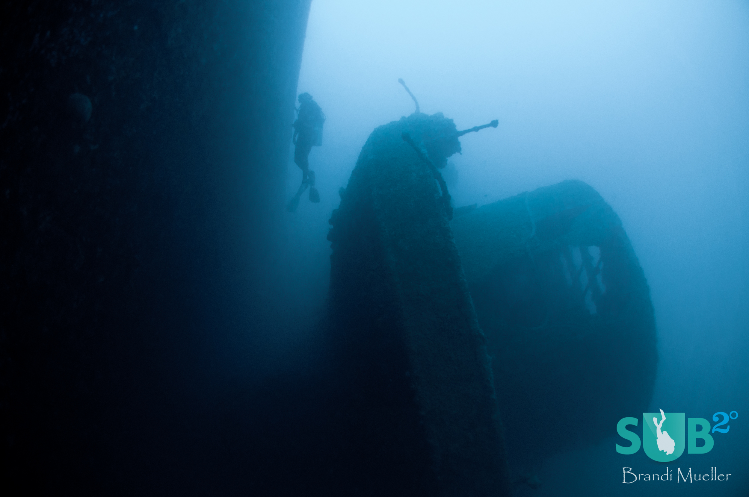 A diver swims between the SMS Cormoran and the Tokai Maru.  The only place in the world where a WWI and WWII ship touch underwater.
