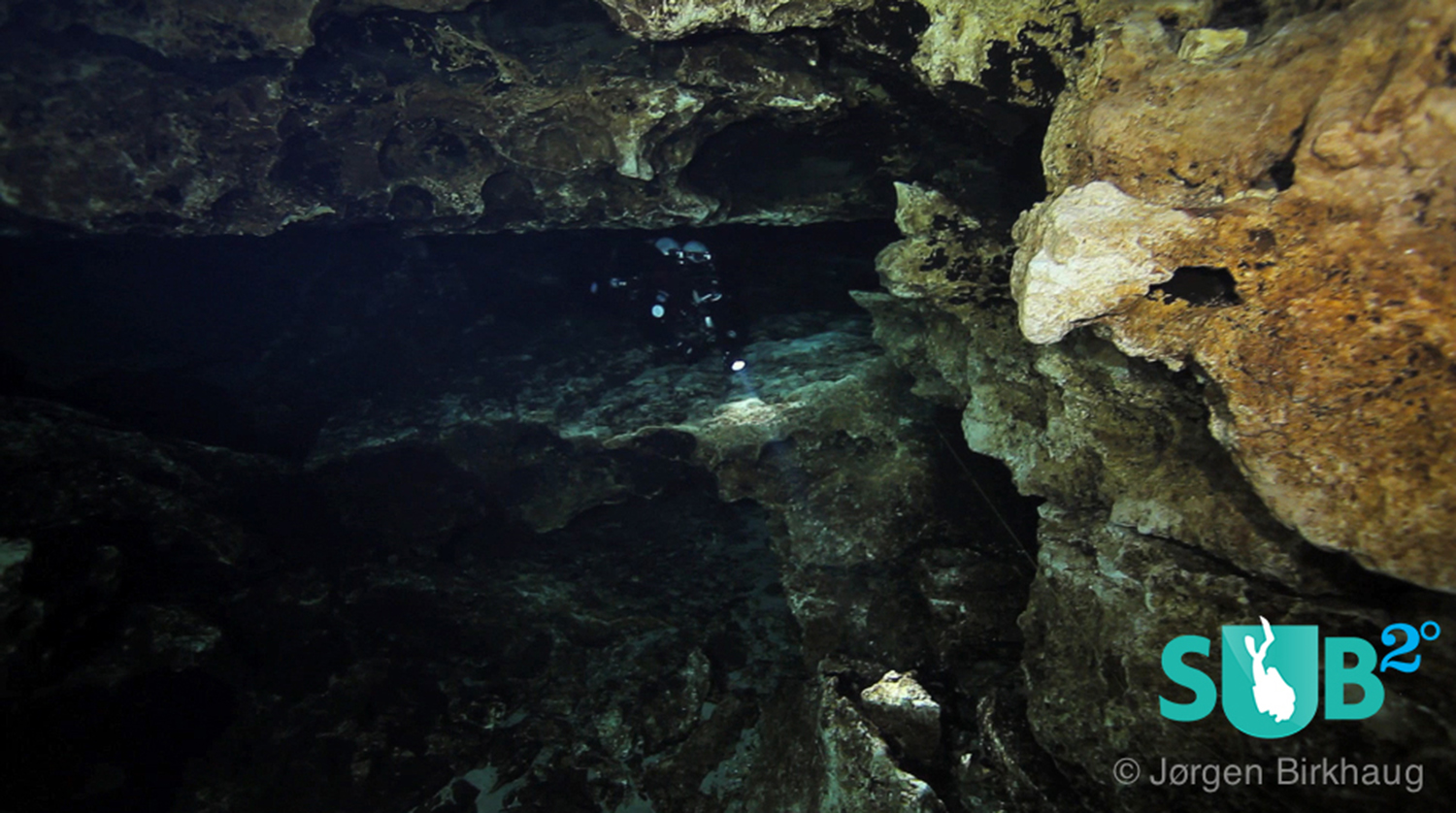 A diver coming through the area known as The Lips in Devil's Eye Cave.