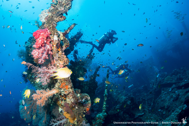 Divers explore the USAT Liberty Wreck in Tulamben, Bali, Indonesia.