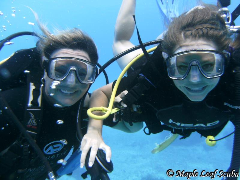 Women divers with Maple Leaf Scuba's dive shop in Cozumel, Mexico