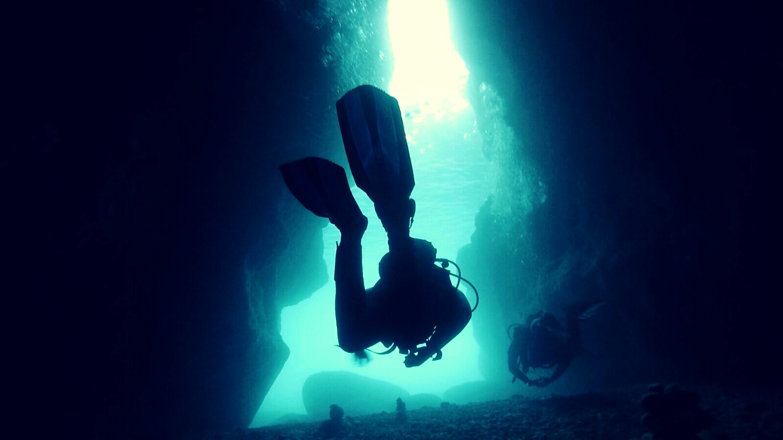 Swimming through xwenji tunnel, a dive site on the island of Gozo
